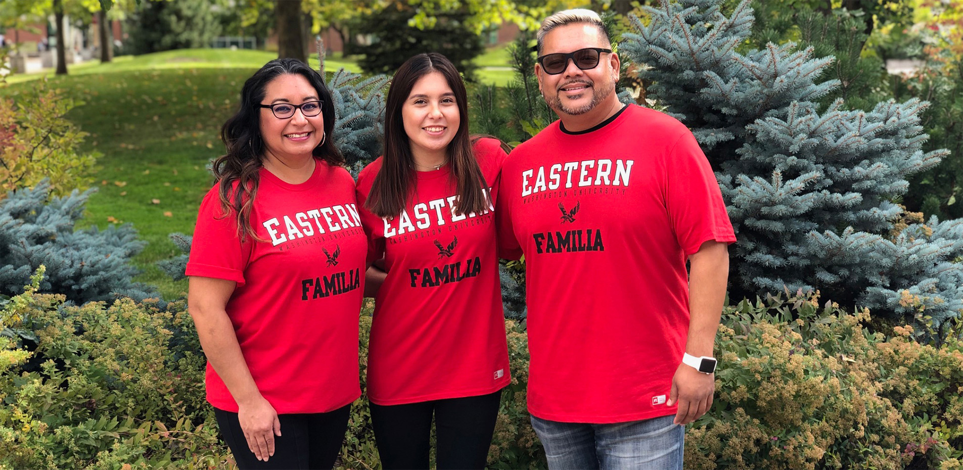 Family of 3 wearing Spanish Eagle merchandise